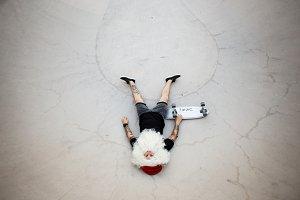 Santa Claus rides skateboard