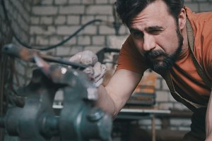 Blacksmith checks the symmetry of the knife blanks