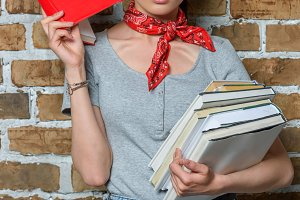 stylish asian girl holding books