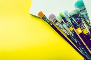 Artist brushes on canvas