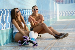 Sporty girls in empty swimming pool