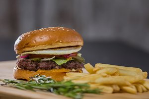 Big fresh appetizing burger with pepper and potatoes