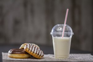 Donuts and milkshake on the table
