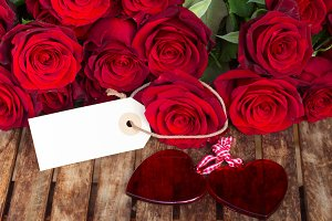 dark red roses with hearts and tag