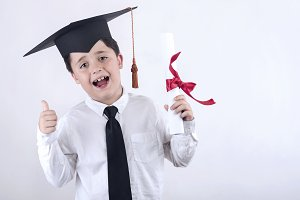 boy with diploma in graduation