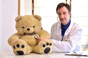 Pediatrician concept teddy front