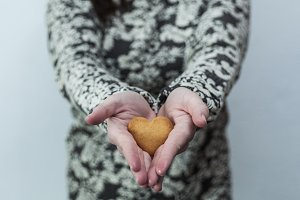 Woman holding a heart cookie
