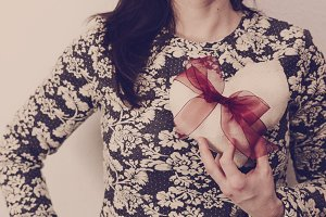 Woman holding a fabric heart