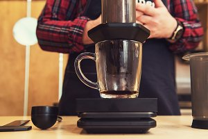 Barista brewing aeropress coffee