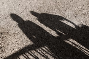 Shadows of two people on the ground