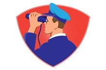 navy captain looking binoculars shie