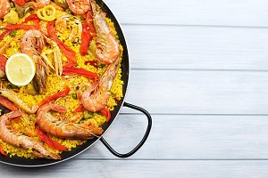 Pot with paella dish. Copy space.