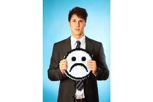 Sad Businessman With Icon