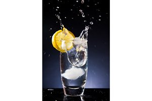 Splashing Glass Of Cold Water On A Black Background