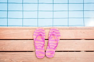 Striped Pink Flip Flops By The Pool