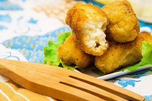 Croquettes on plate on colorful tablecloth