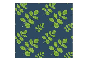 Seamless pattern of leaf on blue