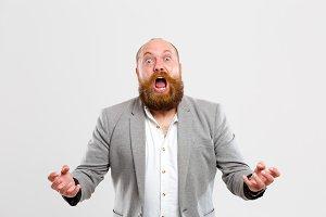 Upset screaming man on empty background