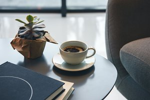 cup of coffee and books on table