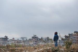Boy looking over slum