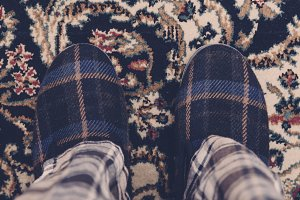 Man feet at home with slippers