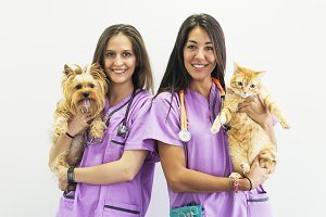 Cheerful women veterinary portrait.