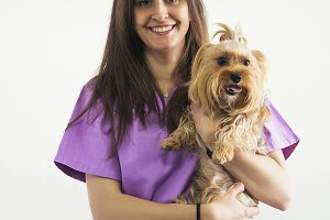 Cheerful woman veterinary portrait.