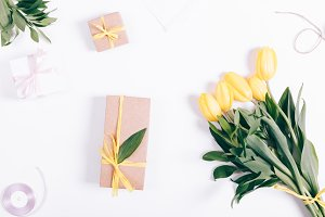 Yellow tulips and gift box