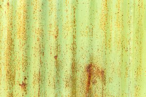 Rusted green painted metal wall