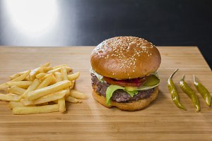 Fresh appetizing burger with pepper and potatoes
