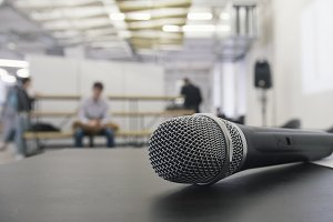 Dynamic vocal microphone at conference, close up