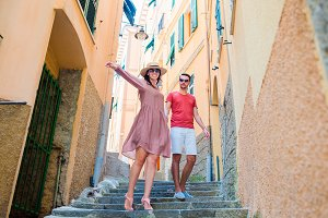 Young tourist couple traveling on holidays outdoors in italian vacation in Cinque Terre