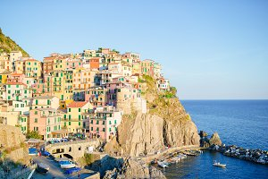 Stunning view of the beautiful and cozy village of Manarola in sunset. Liguria popular region of Italy.