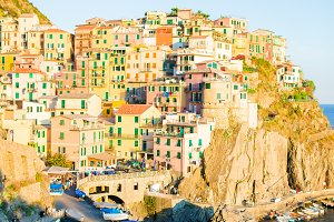 Stunning view of the beautiful and cozy village of Manarola in sunset, Cinque Terre Reserve. Liguria region of Italy.