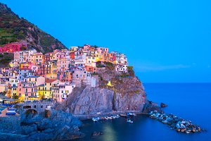 View on architecture of Manarola town in sunset light. Manarola is one of the most popular town in Cinque Terre National park, Italy