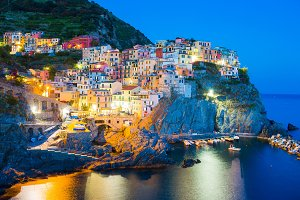 Stunning view of the beautiful and cozy village of Manarola in the Cinque Terre Reserve at sunset. Liguria region of Italy.