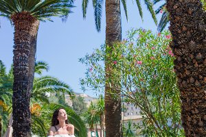 Young woman at outdoor cafe on summer vacation in beautiful resort in Cinque Terre, Italy
