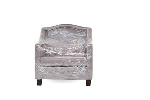 Gray cloth armchair placed on a white