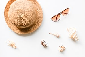 hat with seashells and sunglasses