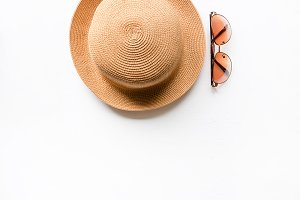 summer straw hat and sunglasses
