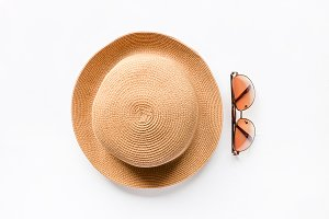 straw hat beach and sunglasses