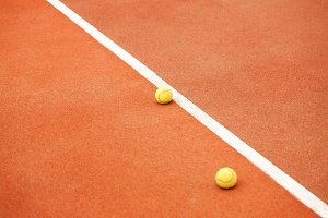 Ball on tennis court background