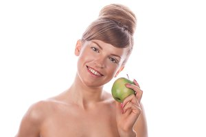 Girl with makeup and green apple.