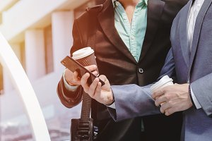 Midsection businessmen using phone