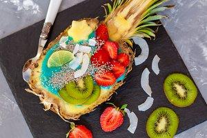 Blue spirulina smoothie in pineapple