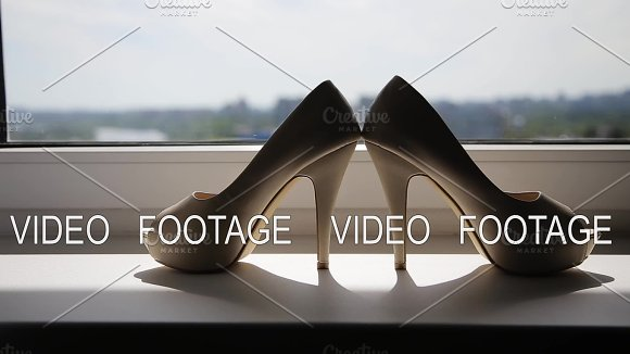 Wedding Shoes Of The Bride At A Window