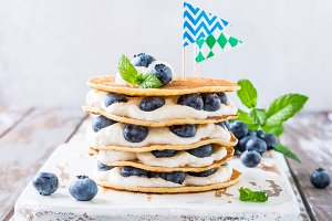 Pancakes cake with yogurt and blueberries
