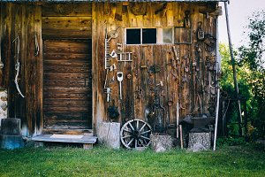 Old barn with tools hanging on.