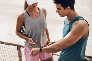Fitness couple checking
