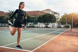 Sportswoman stretching leg
